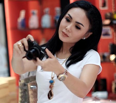 Ms Yuni Shara